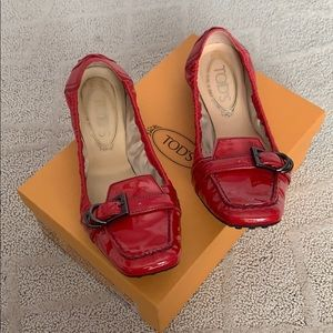 Tod's red flats with buckle.